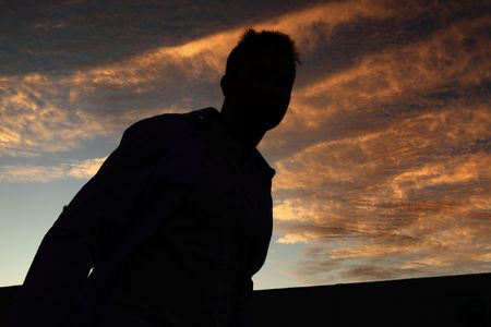 silhouette of a young man climbing on hill Stock Photo - 6453626