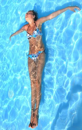 Young girl swimming in pool photo