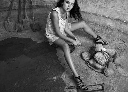 Attractive, girl, stone, hole, old, shovel, metal, brunette, nice, beautiful, sunburn, dress, harmonous, model, idea, conceptual, industrial, pool, water, concrete, adult, footwear, beauty, black, body, cute, elegance, elegant, fashion, female, flirt, gir Stock Photo - 7395917