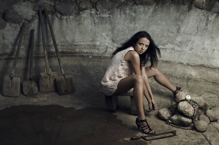 Attractive prisoner in a pink dress.  Vogue style photo. photo