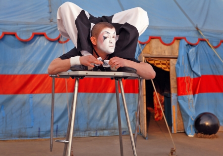 showman: Circus acrobat with a plastic body executes his  tricks Stock Photo
