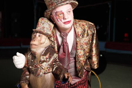 Circus clown with a monkey Stock Photo - 7548741