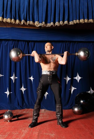 the heavyweight: Portrait of one-eyed circus athlete Stock Photo