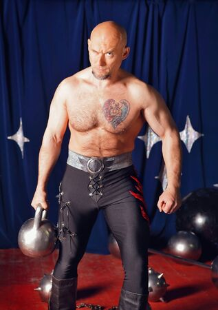 Portrait of one-eyed circus athlete photo