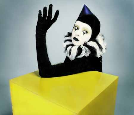 &ETH,&iexcl,ircus fashion mime posing near a yellow square photo