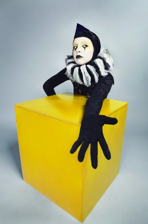 &ETH,&iexcl,ircus fashion mime posing near a yellow square  Stock Photo