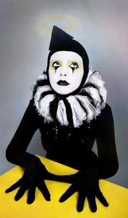 mime: &ETH,&iexcl,ircus fashion mime posing near a yellow square  Stock Photo