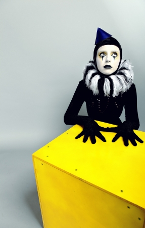 clowns: &ETH,&iexcl,ircus fashion mime posing near a yellow square Stock Photo