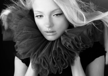 jabot: Attractive blond beauty in a theatrical jabot.   Stock Photo