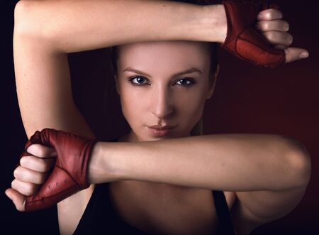 Attractive posing blonde in a red sport gloves.  Stock Photo - 7549059