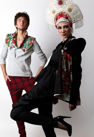 Pair models in exclusive design clothes on manners old-slavic.  photo