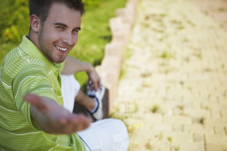 cheerful guy in a green vest Stock Photo - 7722586
