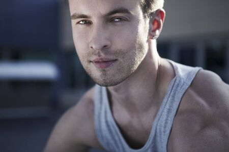 Сlose-up portrait of young male model with a futuristic modern background  photo