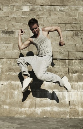 street dance: Young attractive man dancing in urban background  Stock Photo