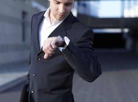 gentlemen: A handsome business man looking at watch Stock Photo
