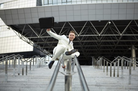 young businessman with briefcase running on stair photo