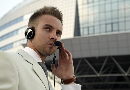 hearing protection: Security agent watching downtown area Stock Photo