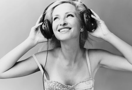 Sexy blond model Listens to music. Stock Photo - 7874936