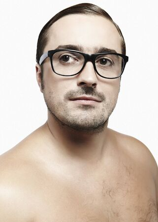 Handsome Middle ages man looking at camera with a pair of glasses photo