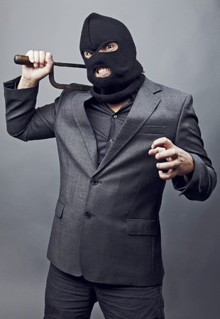 balaclava: Evil criminal wearing military mask isolated on gray background. Stock Photo
