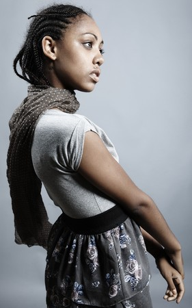 Beautiful African woman with natural make-up pose on grey background. photo