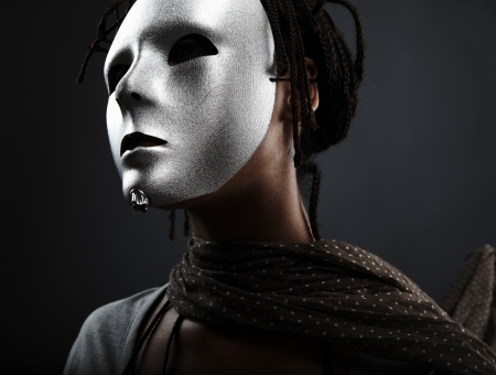 gloomy: gloomy woman in silver mask posing on a black background.