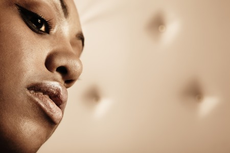 Close-up portrait of Beautiful African woman pose on a leather background. photo