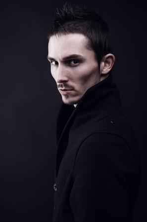 melancholic: Melancholic guy on dark background.