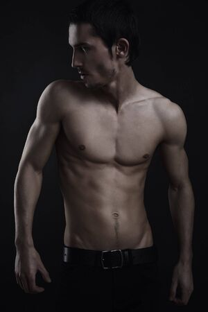 Beautiful athletic caucasian man on dark background Stock Photo - 8201362