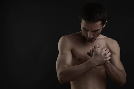 muscular male: Beautiful athletic caucasian man on dark background Stock Photo