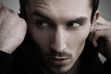 Fashion mannelijke portret. Close-up gezicht. Stockfoto
