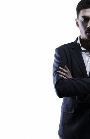 Young attractive man in suit on gray background Stock Photo - 8596641