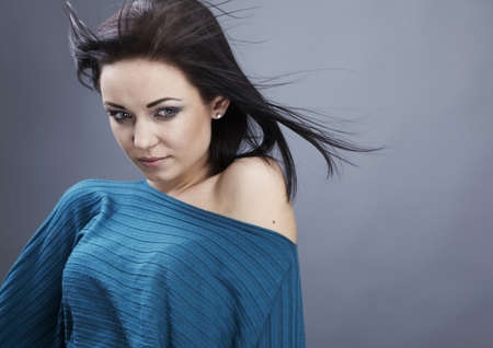 Young woman in a turquoise sweater. Studio close-up fashion portrait. photo