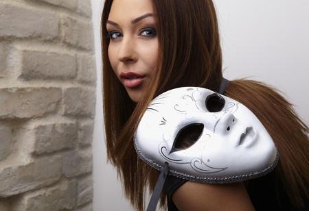 Elegant girl with mask photo