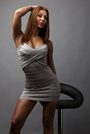 Beautiful girl pose near stylish armchair photo