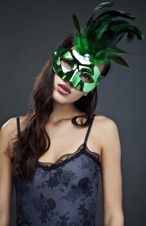 Close-up portrait of sexy woman in party mask   photo