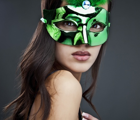 Close-up portrait of sexy woman in party mask