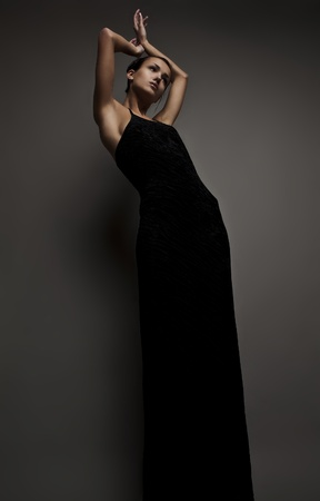 Beautiful woman on black classical dress pose in studio  Vogue style photo   photo