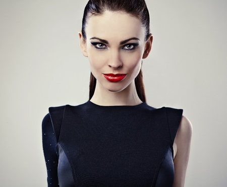 Perfect young woman with red lips   Stock Photo - 12960606