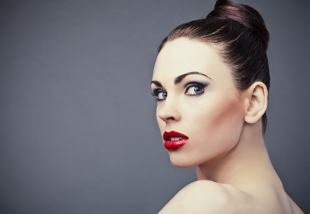 Perfect young woman with red lips   photo