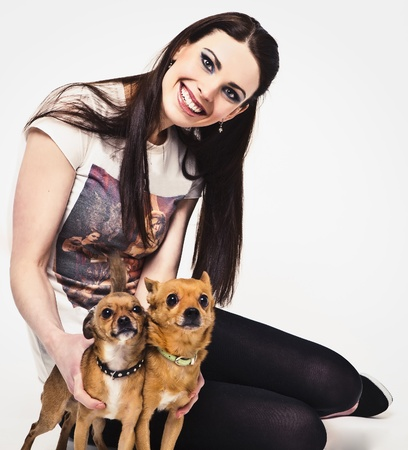 Happy young attractive woman with two dog   photo