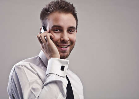 Young handsome businessman talking on mobile phone   photo