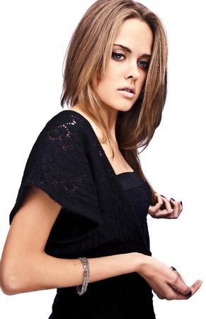Beautiful girl in black classical dress Stock Photo - 12960713