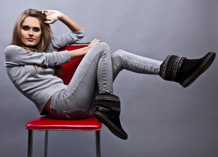Gorgeous young woman sitting on a chair  photo