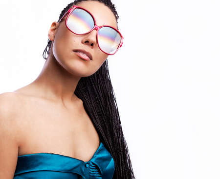 beautiful fashion mulatto woman wearing sunglasses over a white background   photo