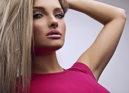 Amazing blond girl in pink   photo