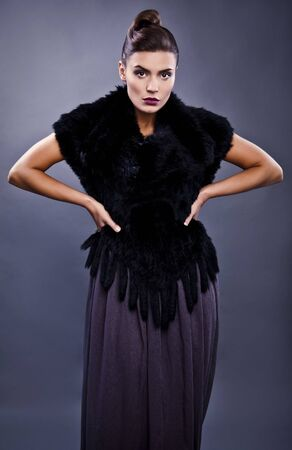 Close-up face portrait of stylish fashionable pretty woman in fur against grey background   Stock Photo - 12962057