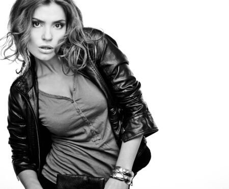 Beautiful young woman on leather jacket   photo