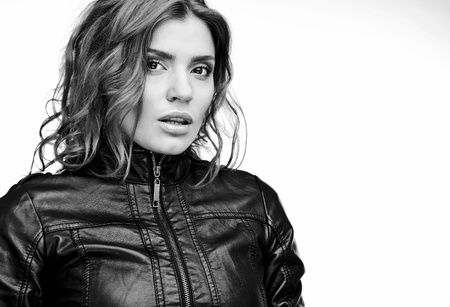 Beautiful young woman on leather jacket  Black-white photo   photo