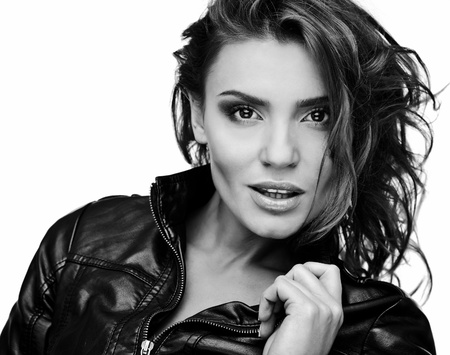 Beautiful young woman on leather jacket  Black-white photo   Stock Photo - 12960764